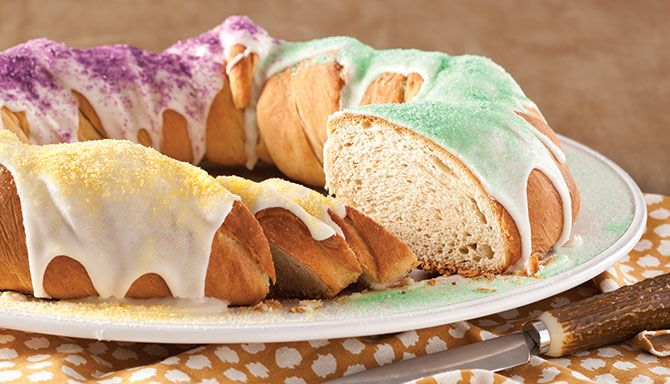 One of the most recognizable Mardi Gras sweets, the traditional king cake is seen in most New Orleanian homes throughout Carnival Season. This traditional king cake is topped with glaze and colored sugars. Make sure to bake one before heading out to the Krewe of Rex parade on Mardi Gras