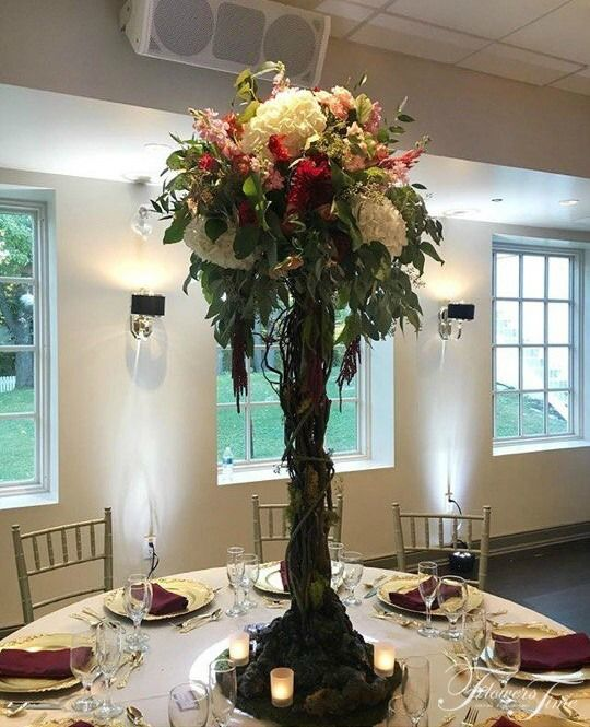 High tree greenery centerpiece by Flowers Time  #wedding#white#bride#florist#toronto#canada#greenery#ranunculus