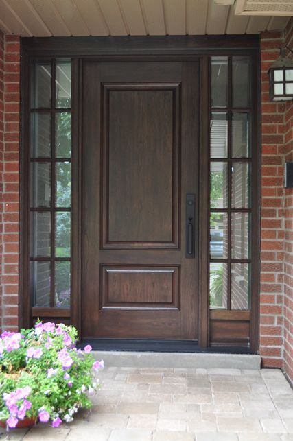This stained woodgrain fiberglass door system gives a classic traditional feel to this home. & Best 25+ Exterior fiberglass doors ideas on Pinterest | Bayer ... Pezcame.Com