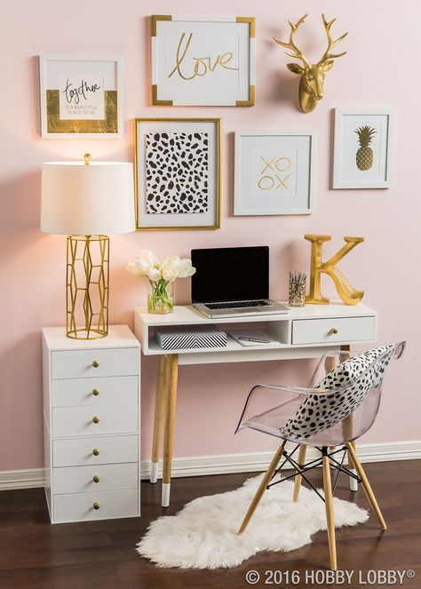 Pretty pink office space with white furniture and gold decor