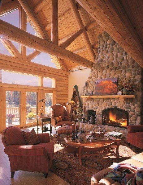 this cozy living room with cedar trusses and stone