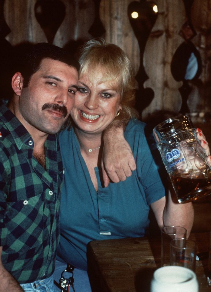 German actress Barbara Valentin is hugged by Freddie Mercury on the 3rd of October 1984 in a restaurant in Munich, Germany