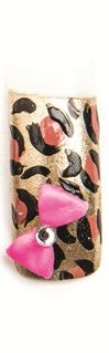 <p>4. Create a pink acrylic bow with a rhinestone center and glue it onto the nail at an angle.</p>