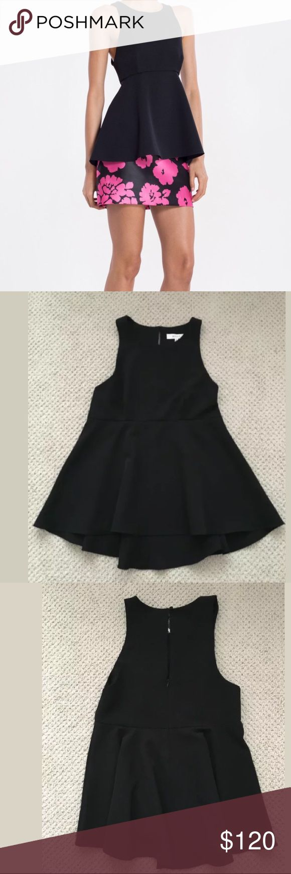NWT Milly Dara Black Top Fashioned in Italian Cady. Sleeveless with seamed waist and peplum.  Invisible zipper 91% poly 9% elastane Made in USA Milly Tops