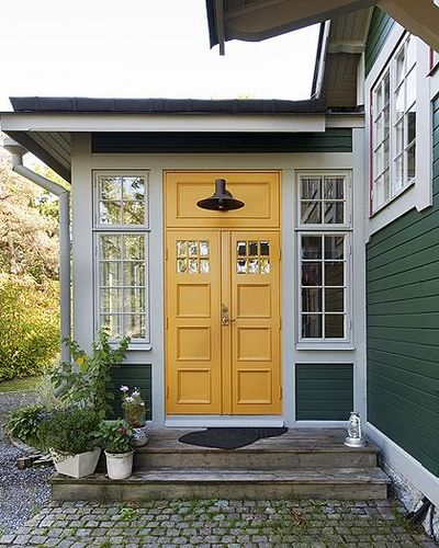 Swedish cottage front // bold yellow door // barn style light fixture                                                                                                                                                      More