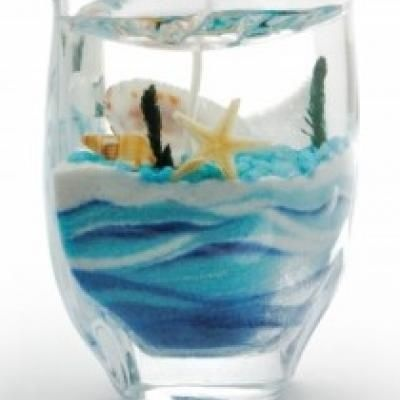 Make Easy Gel Wax Candle (tutorial).  Check out this fun tutorial on a different way to make homemade candles.  You can encase small items in the gel for a unique look.  This would be a perfect way make a gift sentimental by including shells and sand from a special beach vacation or trinkets from a fun date night at the fair.