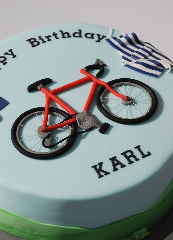 Birthday cake for a cycling, baking and superman fan! Sugar paste bicycle.