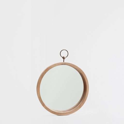 WOOD MIRROR WITH A METALLIC HANDLE