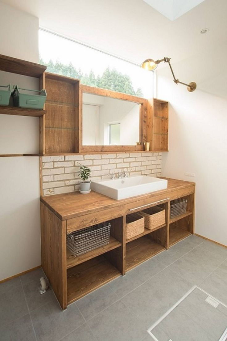 Gorgeous, rustic but modern bathroom with wooden vanity and shalves and a white brick splashback/feature wall. Mirrors by タイラ ヤスヒロ建築設計事務所/taira yasuhiro architect & associates.