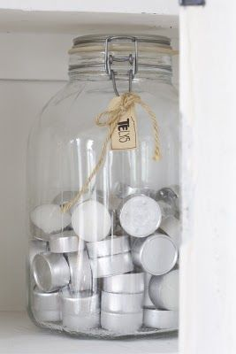 diy idea:  clear container for tealights what a cute way to store your tealights...imagine how pretty it would be with several different colors in a mason jar!
