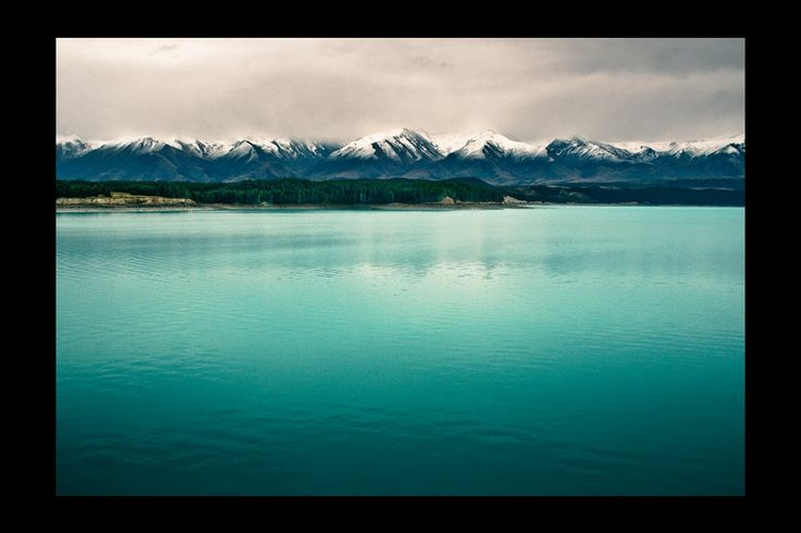 Lake Pukaki mist:     Good views of the main Southern Alp peaks backdrop this Canterbury lake. The water's particular tint of blue comes from glacier-ground particulates.