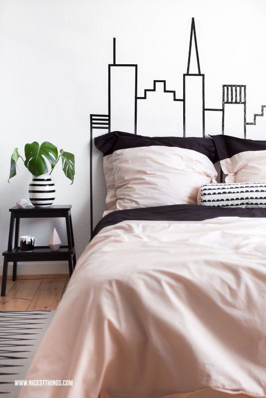 Short on space? Create your own skyline-look DIY headboard with washi tape - source