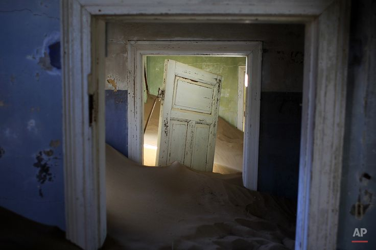 Sand fills an abandoned house in Kolmanskop, Namibia. Photographer: Jerome Delay AP Images:  Blog | Facebook | Twitter | Instagram | License this photo