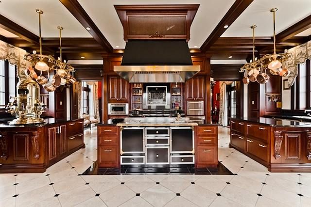 """The gourmet chef's kitchen features solid wood cabinetry, granite counters, 62"""" cooktop, 4 prep sinks, built-in rotisserie appliance, 3 ovens, 2 dishwashers, 2 built-in 36"""" Subzero refrigerators, 4 fridges, hard wired professional Elektra Espresso machine and more."""