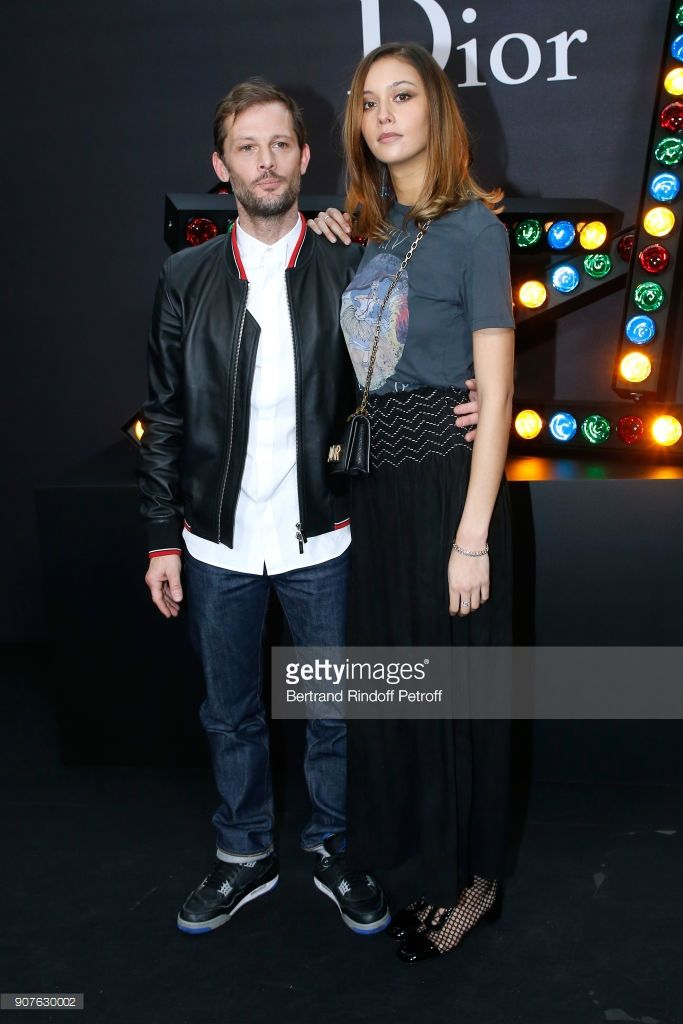 Nicolas Duvauchelle and Anouchka Alsif attend the Dior Homme Menswear Fall/Winter 2018-2019 show as part of Paris Fashion Week on January 20, 2018 in Paris, France.