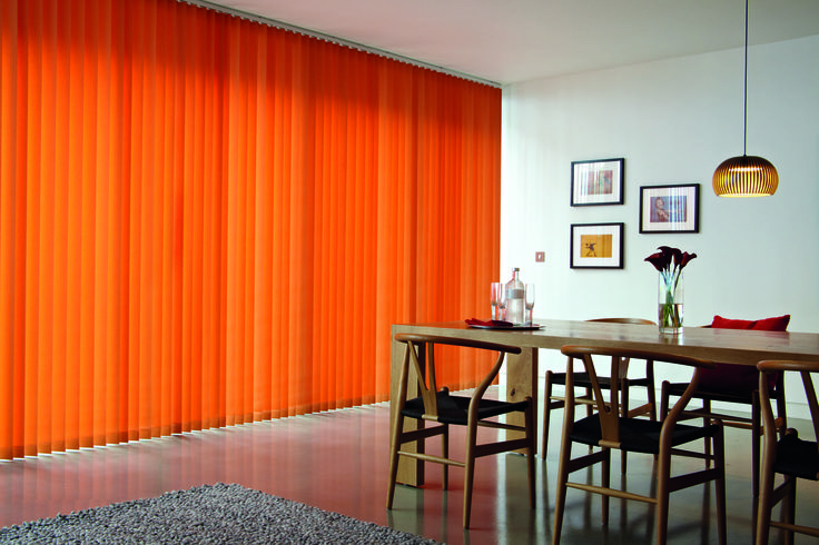 Orange is a great colour to bring warmth to your windows. This room with plain walls is certainly livened up by the addition of this orange vertical blind... imagine the room without the blind - very plain indeed :)     http://www.facebook.com/pages/ZODIAC-INTERIORS-BLINDMAKERS/206646331101