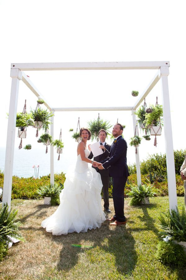 Love the hanging plants from this backdrop. could hang from our ceremony
