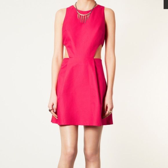 Hot pink topshop dress.. Sale Sleeveless pink pique sundress with cutout side detail. Length 86cm. 100% Cotton. Machine washable... Love it but it's way too big on me.. Unless you like loose fitting clothes.. Wear it anytime looks greats with a cute leather coat!! Then surprise them when you unveil this gorgeous dress!!! Topshop Dresses