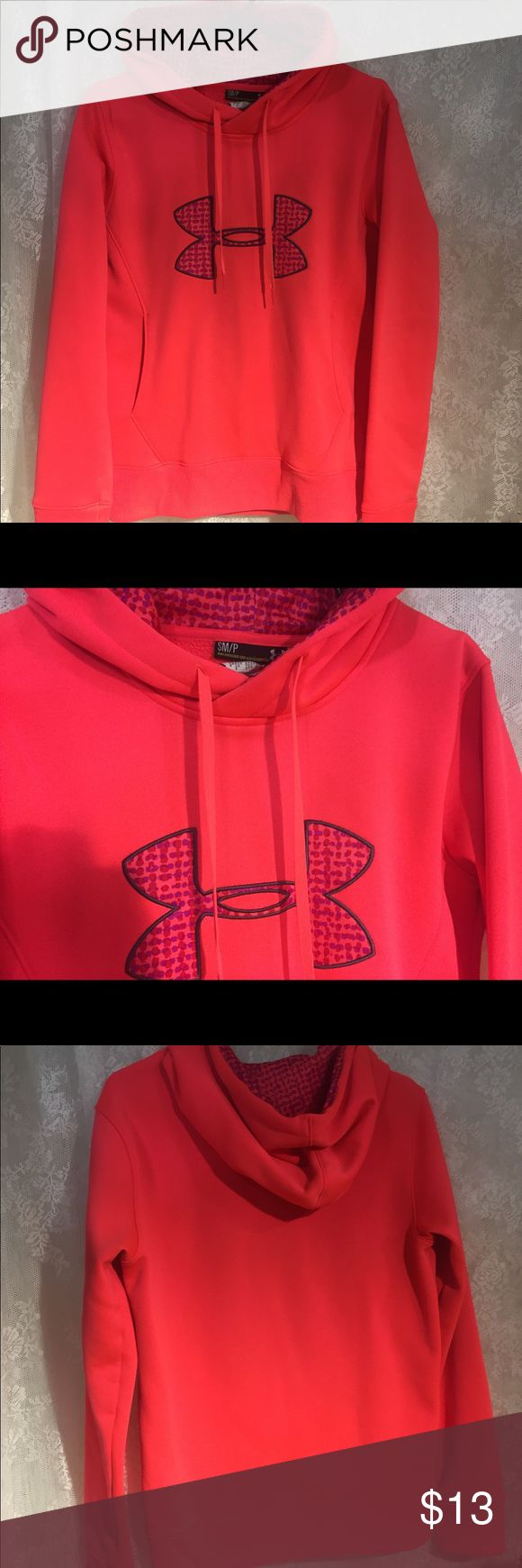 Size small Under Armour hoodie In great condition bright coral or orange with purple size small under armor hoodie Under Armour Tops Sweatshirts & Hoodies