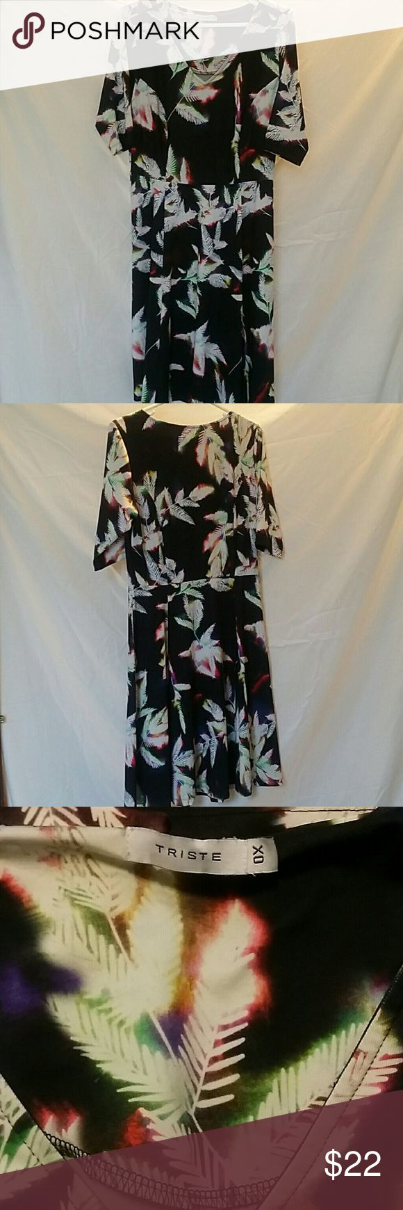 Black leaf pattern dress Super soft material. Quarter length sleeves. Flares out at bottom. Form flattering Perfect for summer.  Trist brand Size 0X Only worn once.  Make an offer. Don't forget to bundle. Smoke and pet free home. For sale on another site as well. Triste Dresses Midi