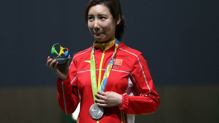 OR: Li Du of China sets a new Olympic record in the women's 10m air rifle competition, at the Olympic Shooting Centre