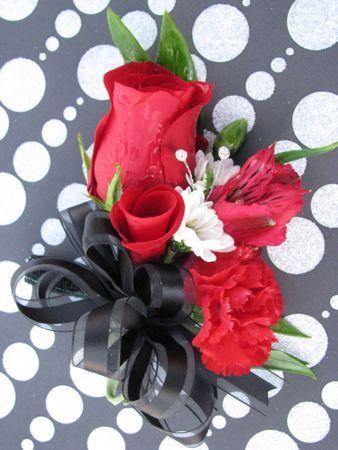 Google Image Result for http://floralshowers.com/public_html/floralshowers/wp-content/uploads/2012/02/Red-Rose-Dance-Corsage.jpg