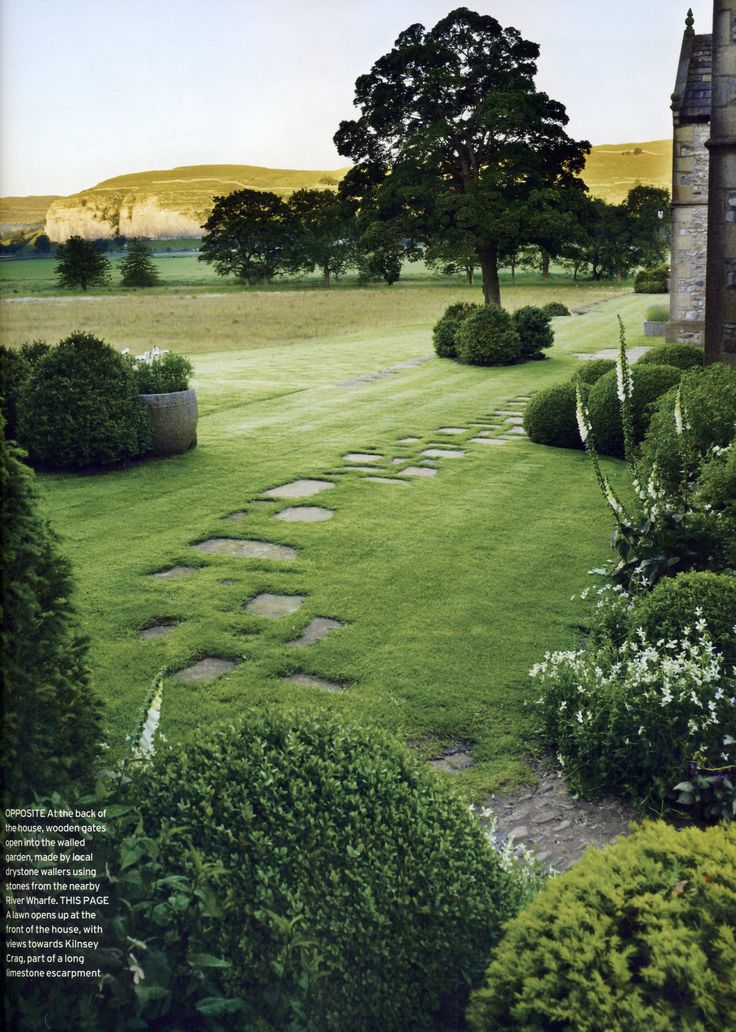let us stop and all admire the plush grass and the stepping stones. im a use that in my backyard