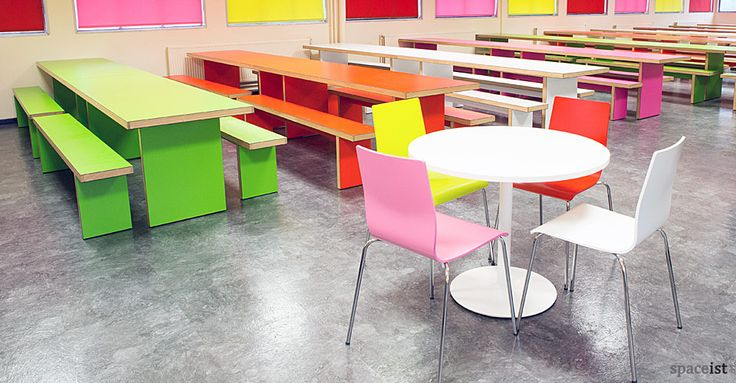 Cool, green, red pink and white school canteen tables and benches.