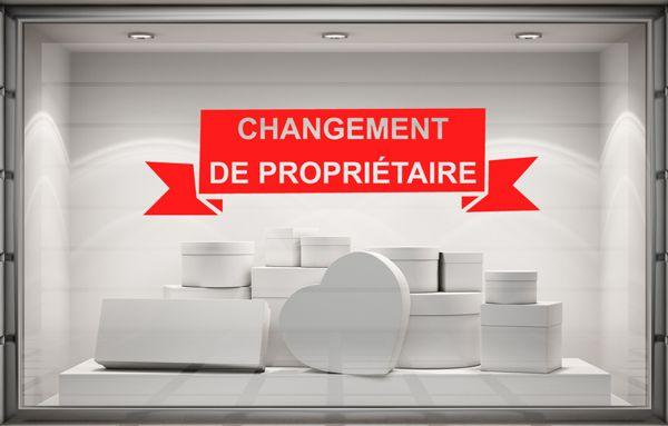 Sticker adhésif Changement de Propriétaire en lettrage adhésif.
