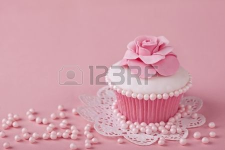 Cupcake with pink flowers on a stand