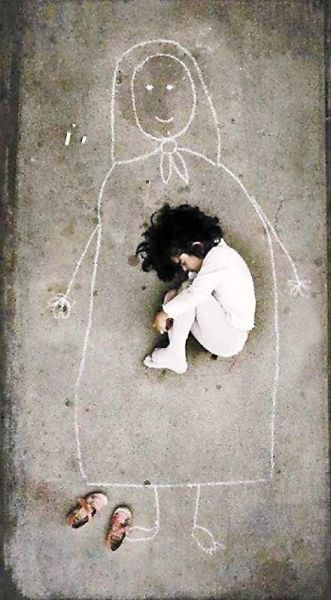 Image by an Iraqi artist taken in an orphanage. This little girl has never seen her mother, so she drew a mom on the ground and fell asleep with her. <--- being like a mother to a girl like this is a dream