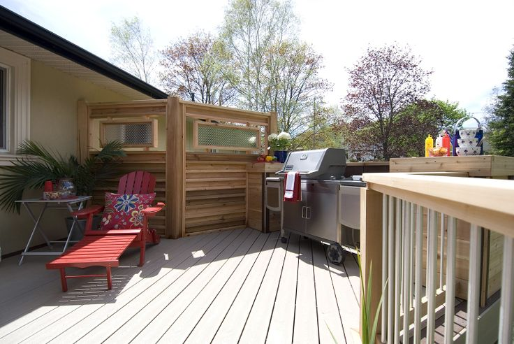 These slick cedar and metal privacy screens add a for Metal privacy screens for decks