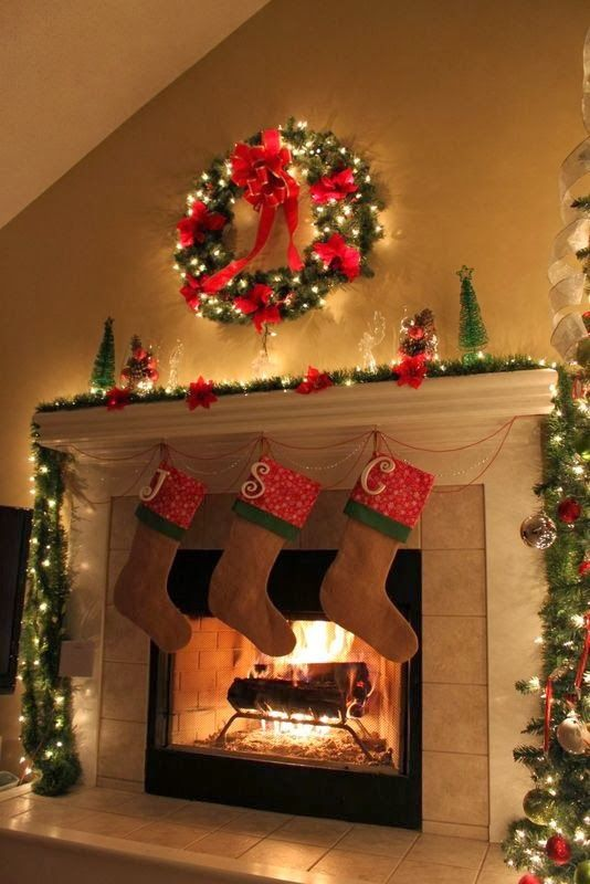 Christmas Love the Ideas I can't wait to decorate my fireplace for christmas.