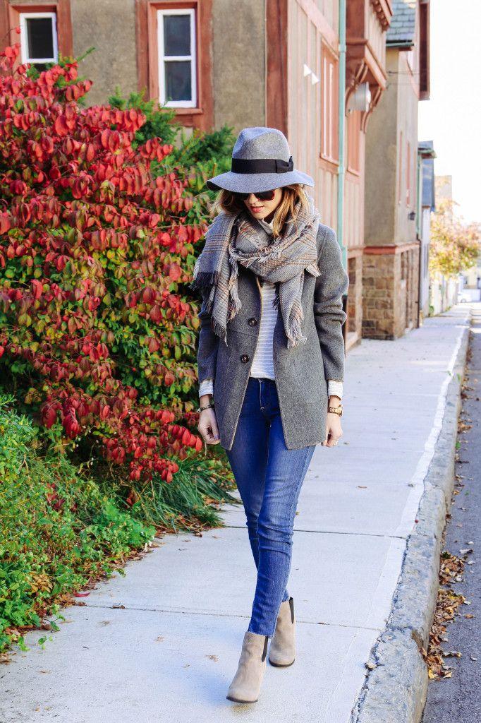 Jess Ann Kirby is wearing a grey plaid scarf