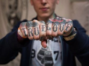'True love' knuckle tattoos via Knuckles 365