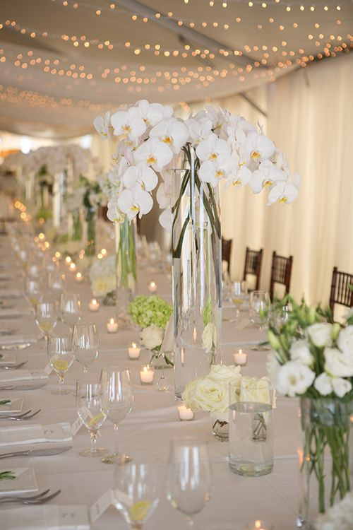 Centerpieces of hydrangeas, roses, and orchids | Brides.com