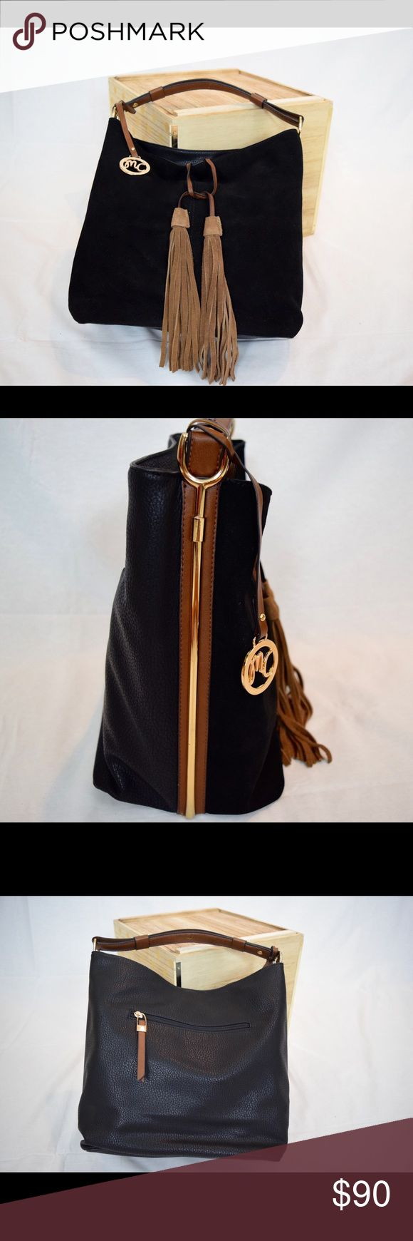 """BLACK VEGAN SUEDE LEATHER TOTE/SHOULDER HANDBAG This classy purse features high quality vegan suede leather with fabric lining, classic gold trim, and tan leather tassel. Superb quality. ❤️  -Fabric lining (with inside pockets) -Strap is adjustable, tassels are 9""""  -Base is 11.5""""x7.5"""", 12"""" in height, 14"""" wide at top, weight 1.3 lbs Cindy's Faves (Miss Caprice) Bags Shoulder Bags"""