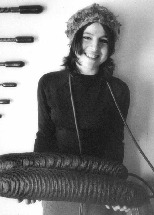 Eva Hesse (1936-1970) holding Ingeminate, 1965.    Post minimalist sculptor, known for her pioneering work in materials such as latex, fiberglass, and plastics.