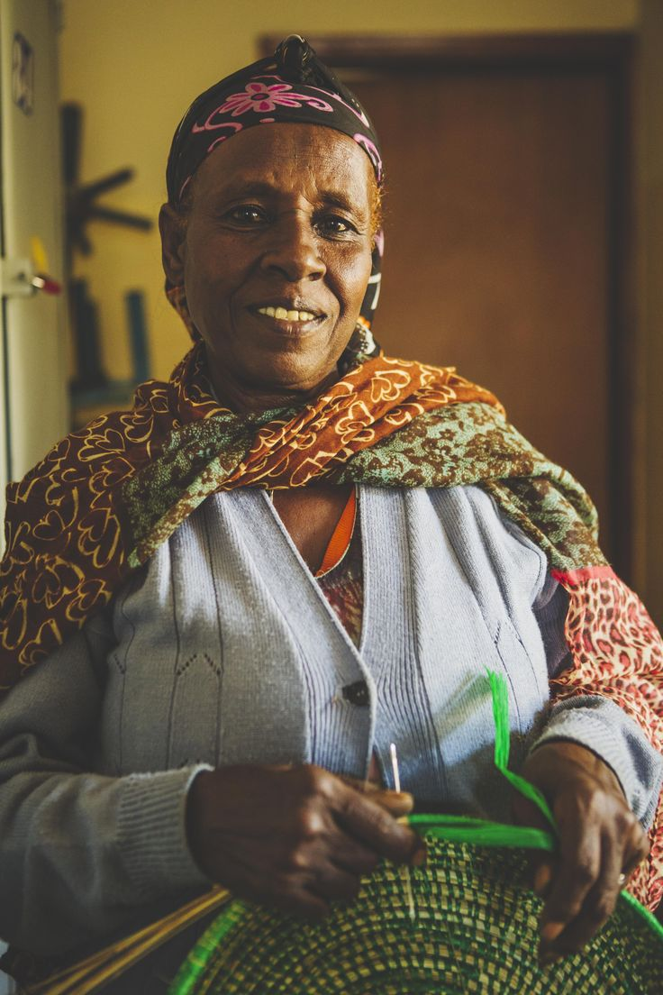 """Before working here, I used to make injera in people's homes. That was really tough work. I came here to learn how to do something new. I wanted to do embroidery, but my eyes are too bad, so now I make baskets and that's good enough!"" says Belaymesh, an artisan from Ethiopia © ITC Ethical Fashion Initiative & Louis Nderi"