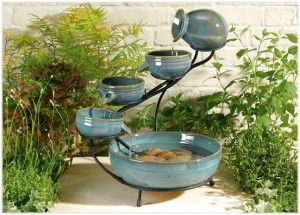 Attractive Feature For Your Garden, A Fountain With Four Levels And A Nice Blue Color Kemarik