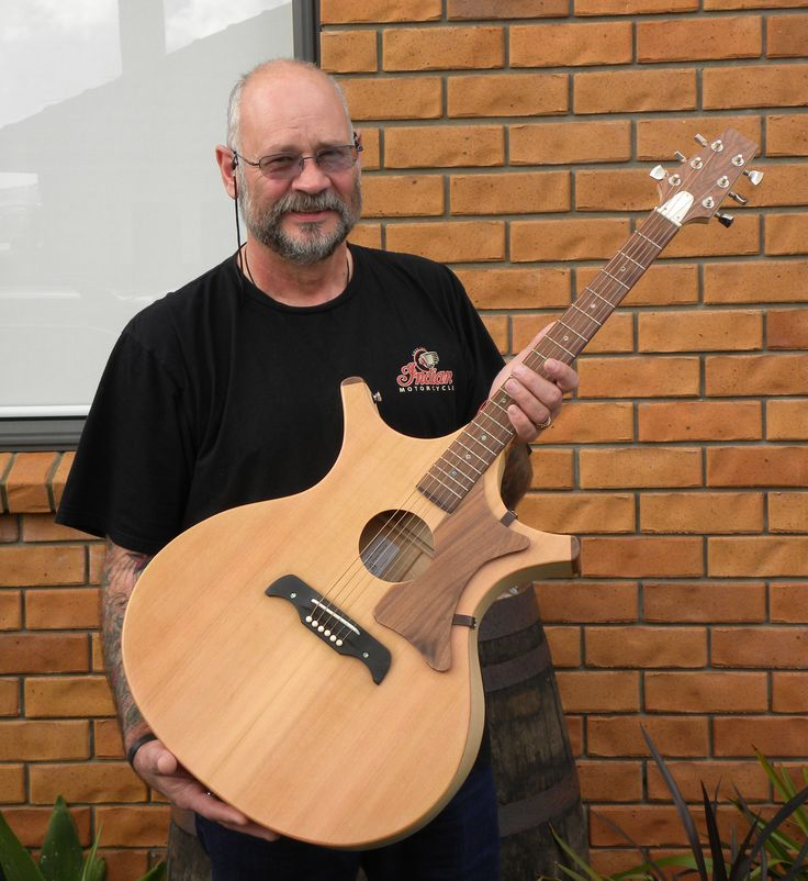 Bryon, from Whangarei, Northland, NZ. he purchased the first Barebones Crown Royale guitar, a Jumbo, yep it was BIG... but he loves it.