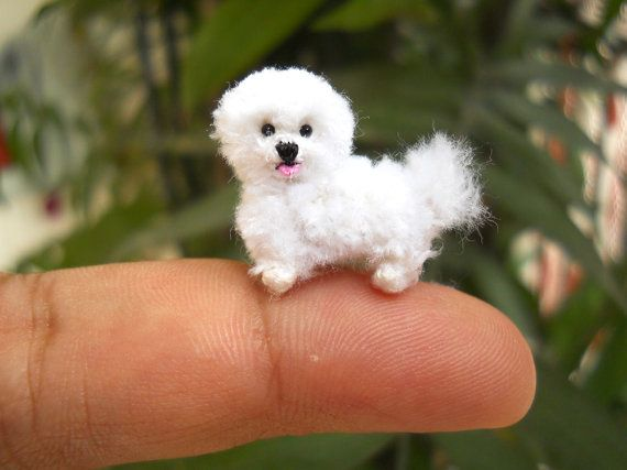 Handmade tiny crochet dog - white Bichon Frise puppy is made of embroidery threads.    Size: Aprox. 1 inch ( 24 mm) long and 0.8 inch (18 mm) tall.