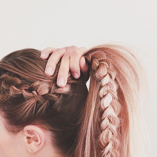 Combining three hairstyles into one look is easier than you think. This cool style by Kristin is a plain ponytail on one side, and a French braid and basic three-strand on the other. To get the look, begin by French-braiding a section of hair on one side of our head. Stop when you hit around parallel to your ear, and transition to a three-strand braid. When you hit the bottom of your hair, tie it off with a clear elastic — and loosen your braid a bit for an extra-boho vibe. Now gather your…
