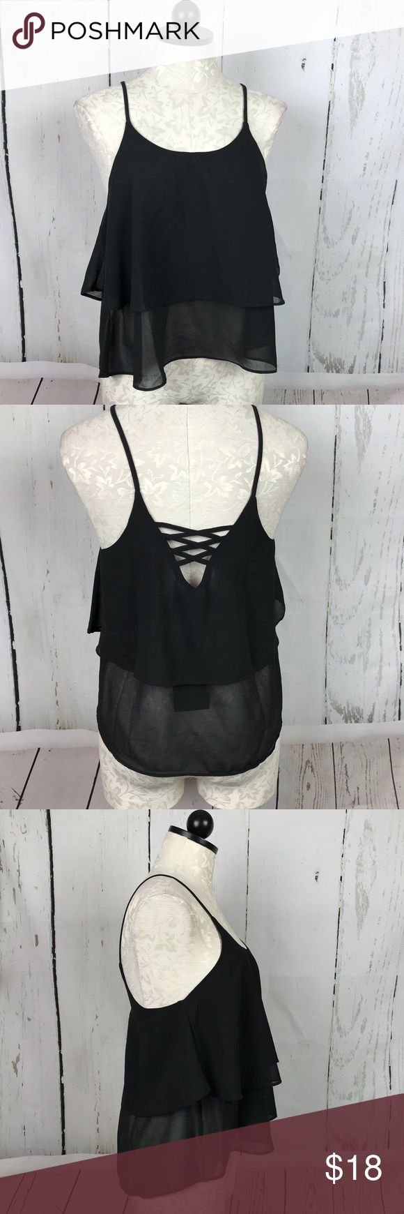 "New Doublju CrissCross Tank Brand new with tags! Pretty, boutique ruffle sheer cropped tank with spaghetti straps and crisscross back. Top ruffle is layered for modesty and bottom ruffle is more sheer 100% polyester 24"" length, 19"" underarms across front Doublju Tops Tank Tops"