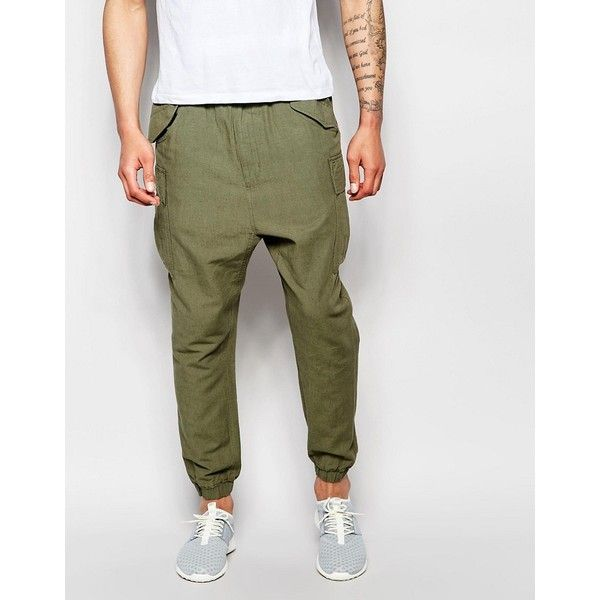 ASOS Slim Drop Crotch Joggers In Khaki Textured Fabric (165 PEN) ❤ liked on Polyvore featuring men's fashion, men's clothing, men's activewear, men's activewear pants, green and asos