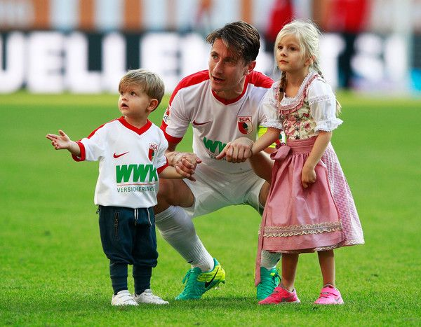 Paul Verhaegh of Augsburg celebrates victory with his children after the Bundesliga match between FC Augsburg and SV Darmstadt 98 at WWK Arena on September 24, 2016 in Augsburg, Germany.