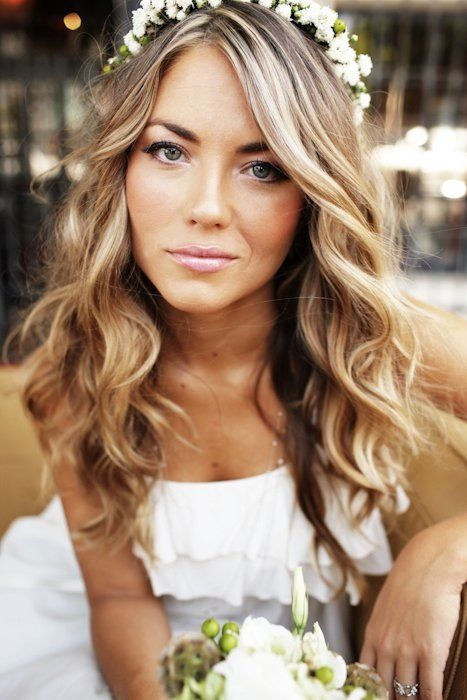 Try a loose curl and flower halo for a Bohemian look!