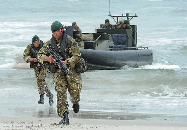 Royal Marine Commandos from Lima Company wearing Multi Terrain Pattern camouflage, are pictured exiting an Armoured Raider Craft during amphibious training on Exercise Auriga 10 in Virginia, USA.