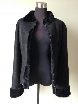 Save 78% French Laundry Shearling Size 4  Hot, hot, hot!!  French Laundry lambskin jacket by Neto.  Fully fur lined in black, roll up cuffs, snap button front and black fur lined collar.  New with tags Original Retail:  $1399 + tax Our Price:  $350