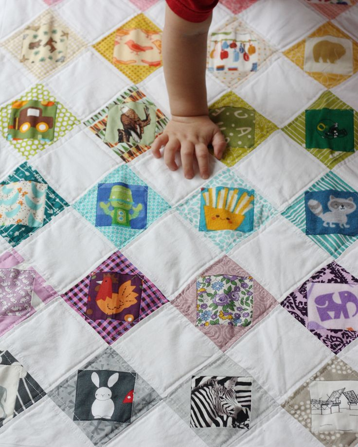 I Spy Economy Block Scrappy Quilt Fussy cut novelty squars add complementary fabrics around.